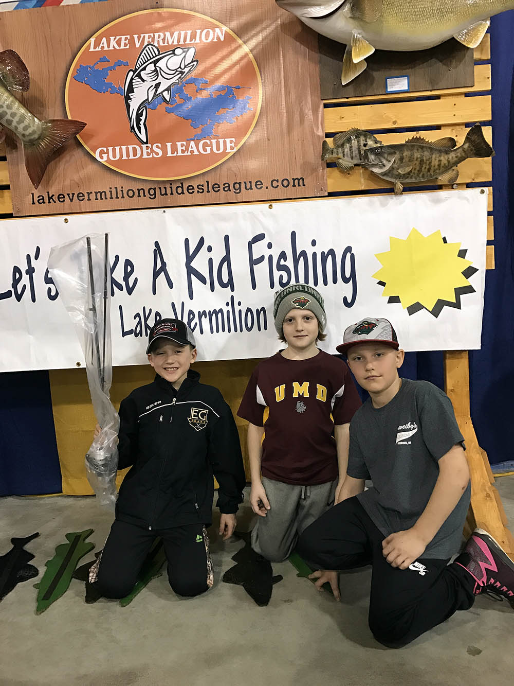 Kids posing for Lets Take a Kid Fishing event